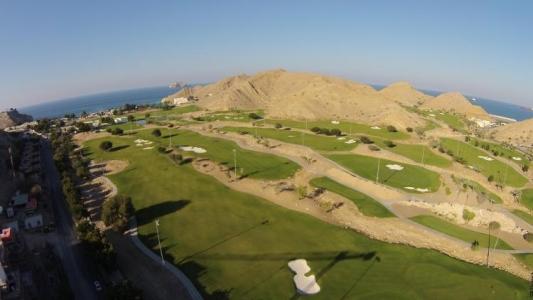 Vue aérenne golf à Muscat avec votre pro