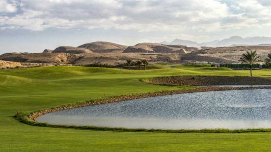 Lac et montagne Golf de Muscat Hills avec votre pro